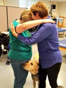 We took many great photos, but technology is cursing me today, and this is the only one I can get uploaded. This is Terran, my case manager at Shepherd Center, and Gallion, one of the therapy dogs, who wanted a piece of the action.